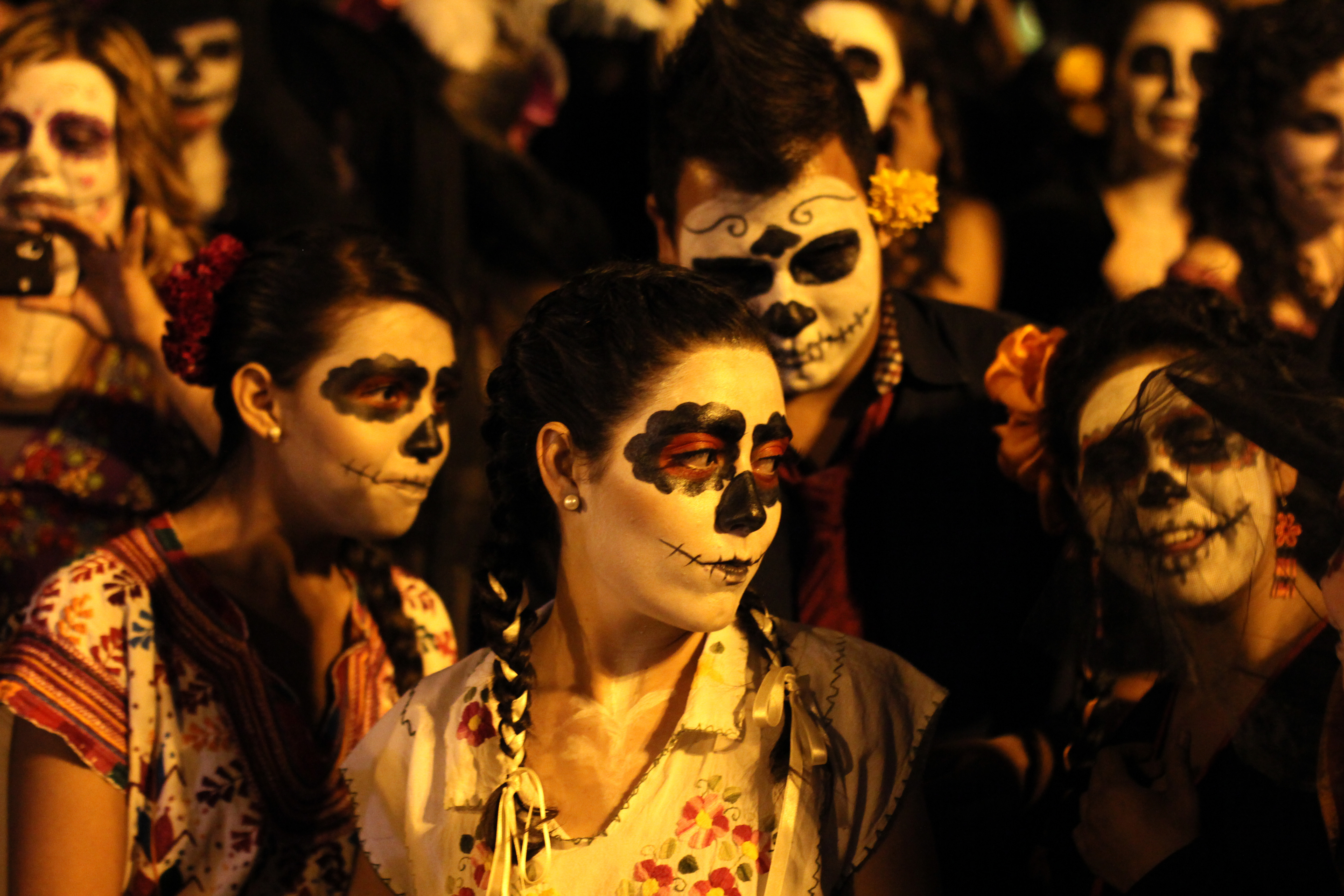 "People disguised as ""Catrina"" during the celebration of the day of dead in Guadalajara, Mexico on November 02, 2012. La catrina is the Mexican representation of death and this year celebrates 100 years of having been created by the Mexican artist Jose Guadalupe Posada. AFP PHOTO/Hector Guerrero (Photo credit should read HECTOR GUERRERO/AFP/Getty Images)"