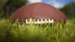 American footbal ball in the grass